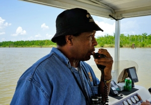 Major Womack telling stories on the water